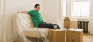 Man relaxing in new home