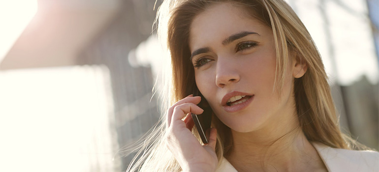 A woman speaking on the phone