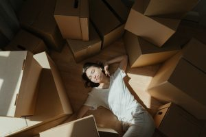 A woman with cardboard boxes