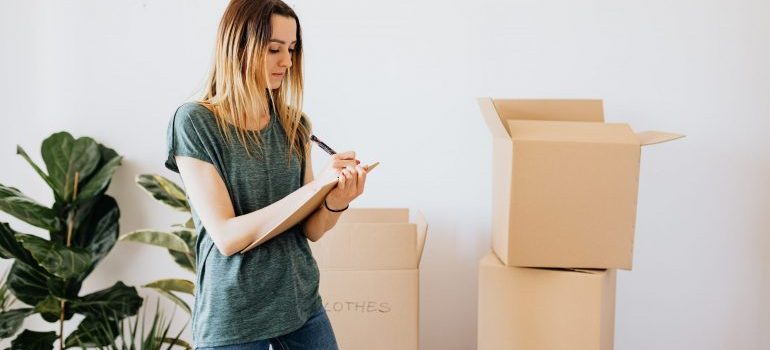 Writing down notes one month before your moving day