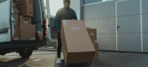 A mover transporting boxes on a dolly