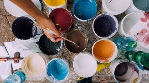 Paint buckets inspiring one to think about home renovation tips