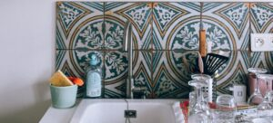 painted kitchen tiles after remodeling a kitchen on a budget