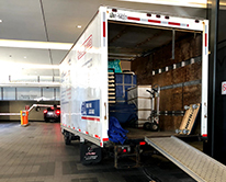 Full moving truck in parking garage