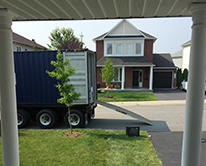 Moving truck on street outside of house