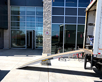 Moving truck outside of building with ramp