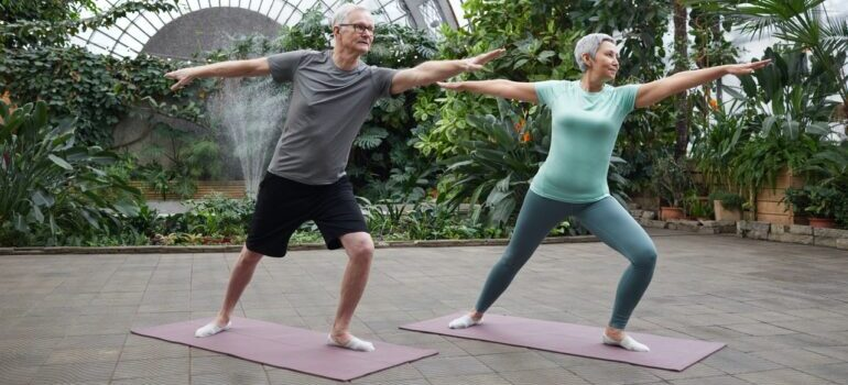 A senior couple practicing yoga