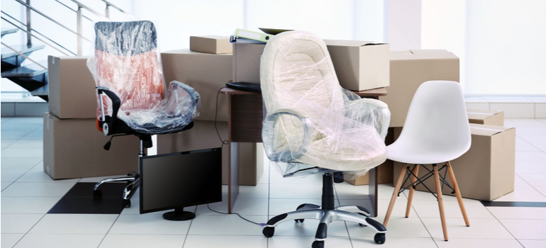 packed boxes and wrapped chairs for an office move